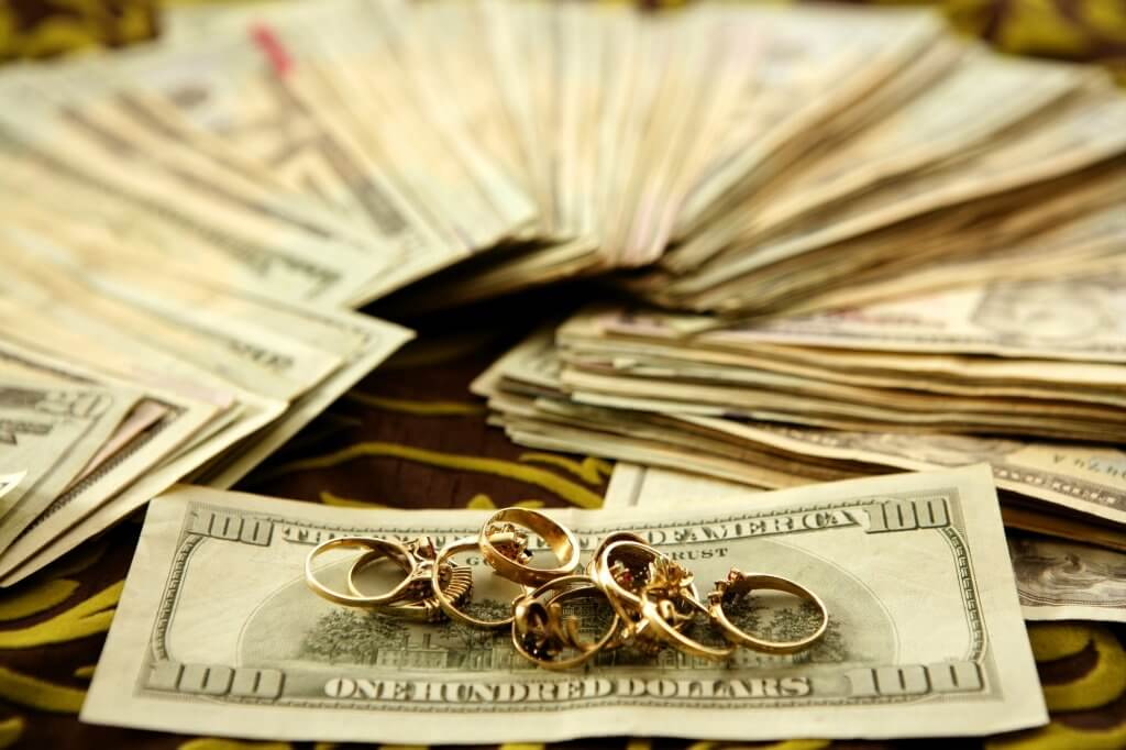 collection of rings on top of cash