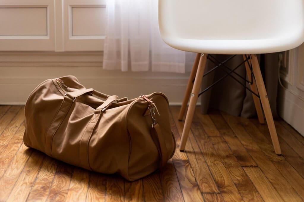 tan duffel bag