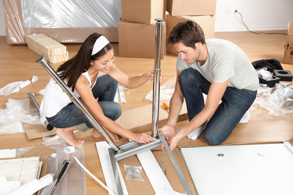 Couple taking furniture apart