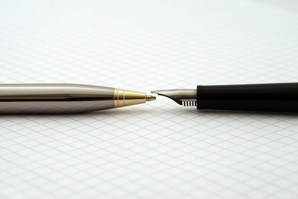 ballpoint pen tip-to-tip with fountain pen