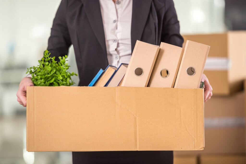 man holding box of office equipment