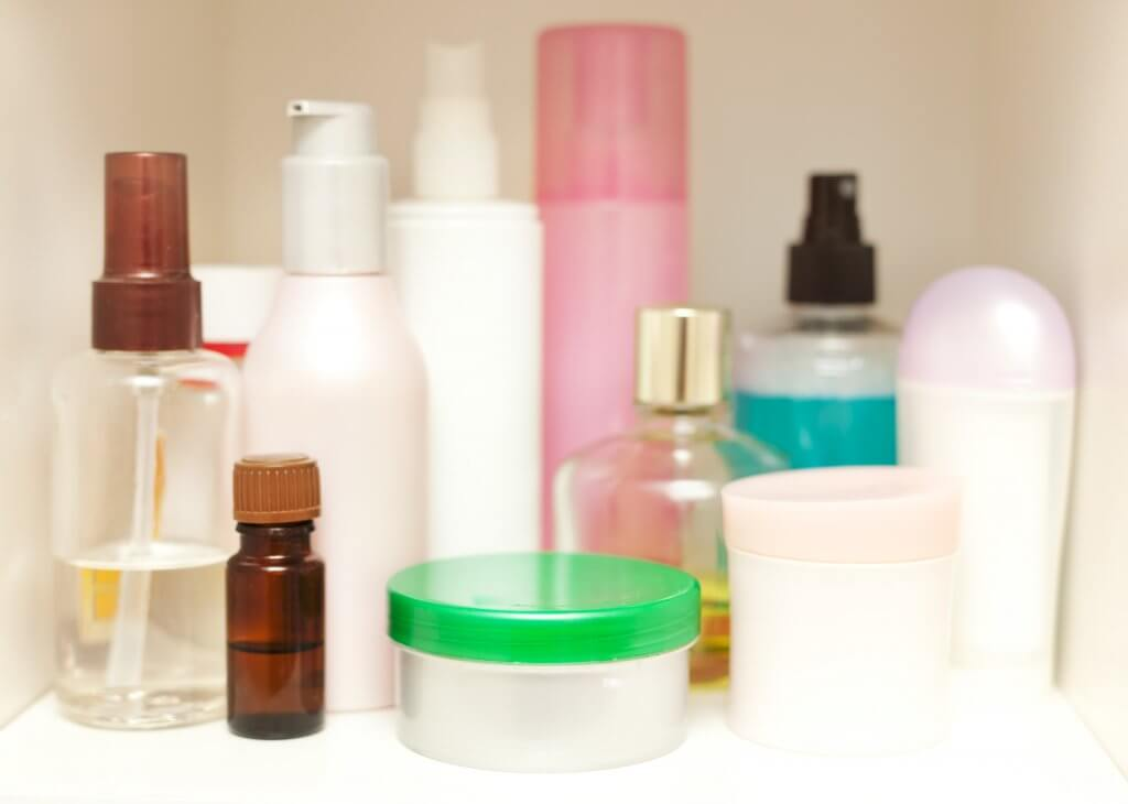 skin care bottles in medicine cabinet