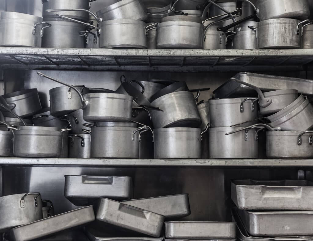 Shelf full of pots and pans
