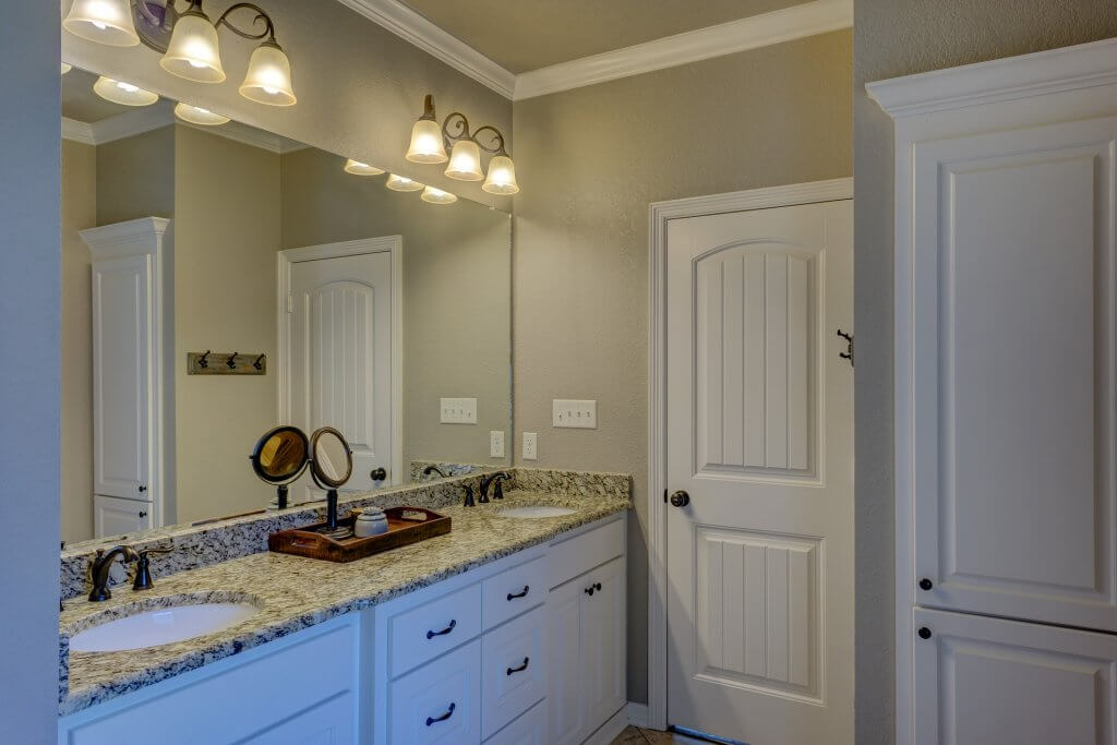 modern white bathroom with his and hers sinks