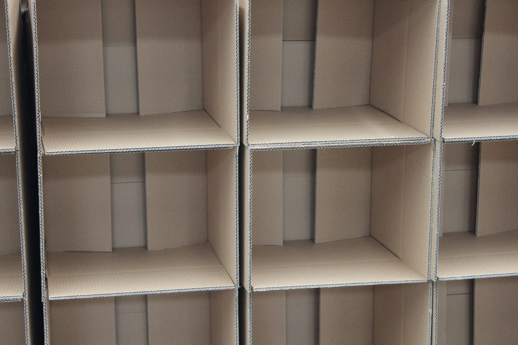 stack of empty cardboard boxes turned on their sides