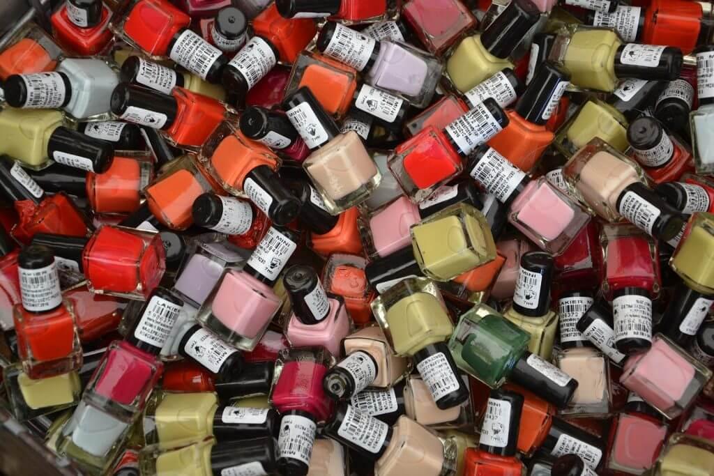 pile of nail polish bottles