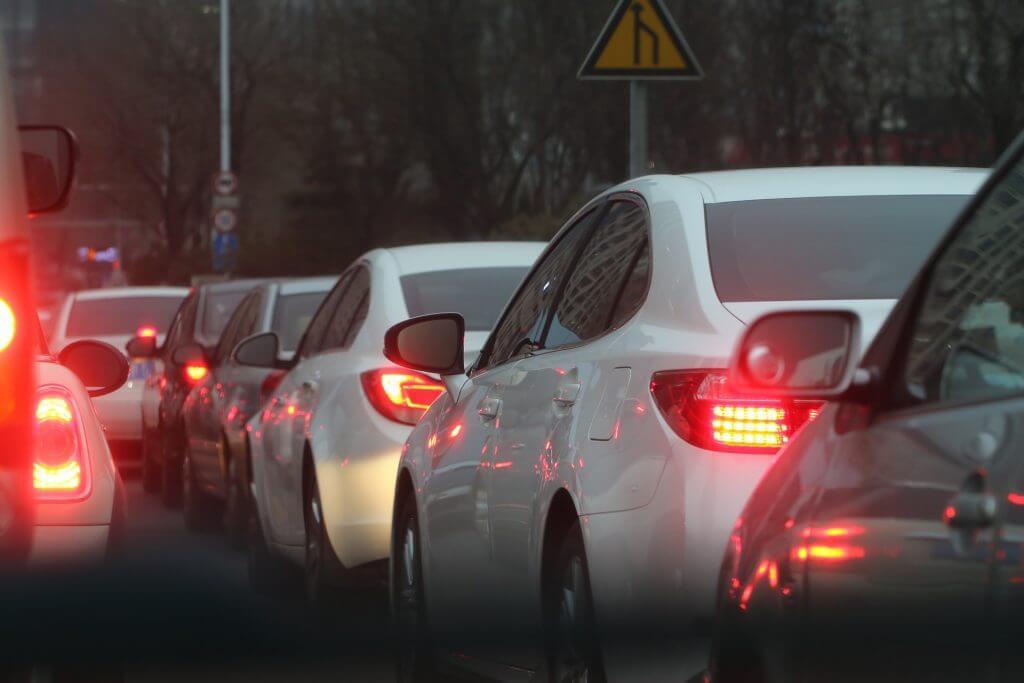 row of car brake lights in traffic jam