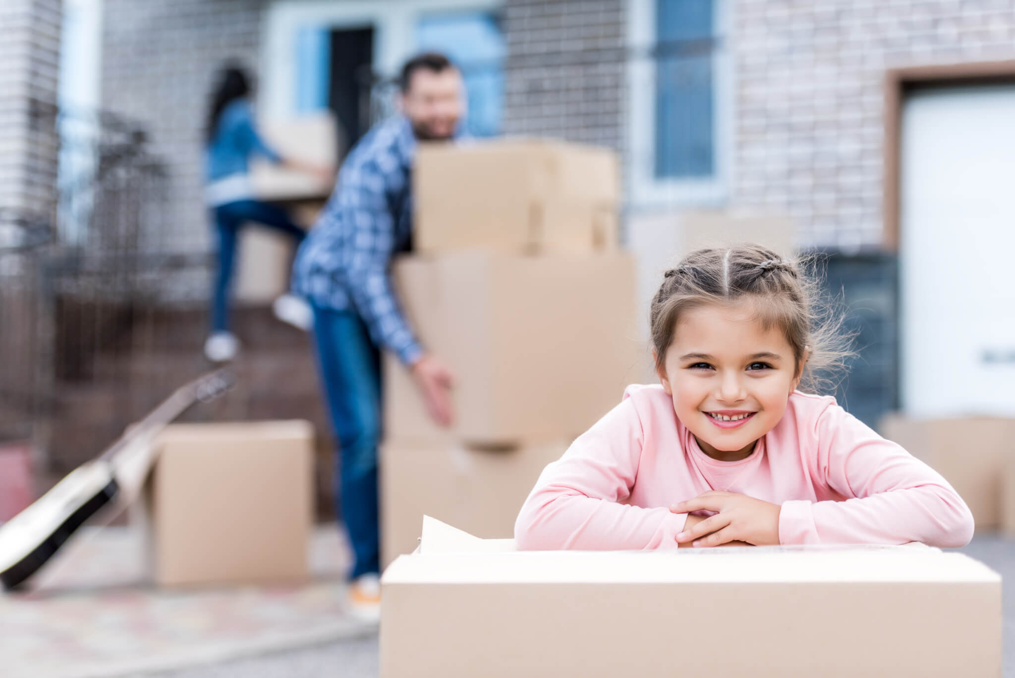 little girl with box on moving day