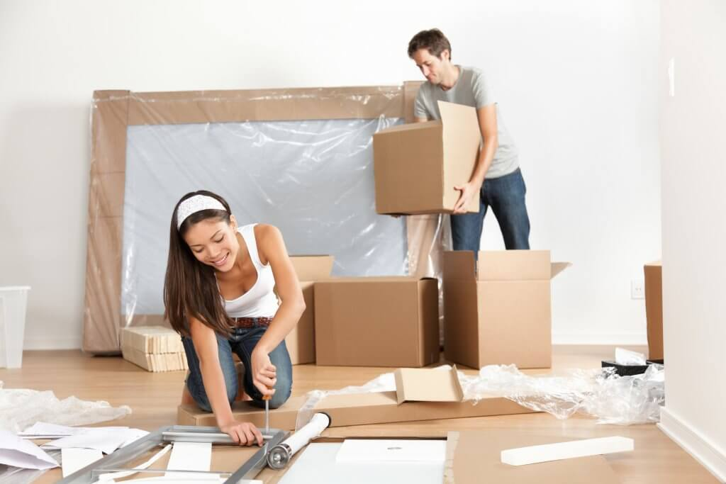 couple packing furniture