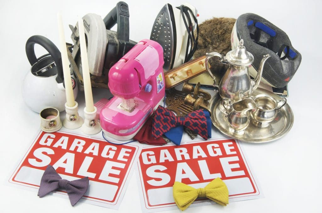 A garage sale is a great way to declutter before a move and earn some money.