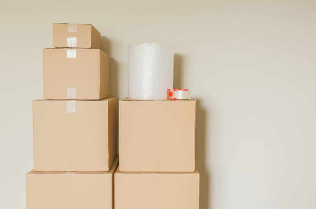stack of moving boxes with tape and bubble wrap