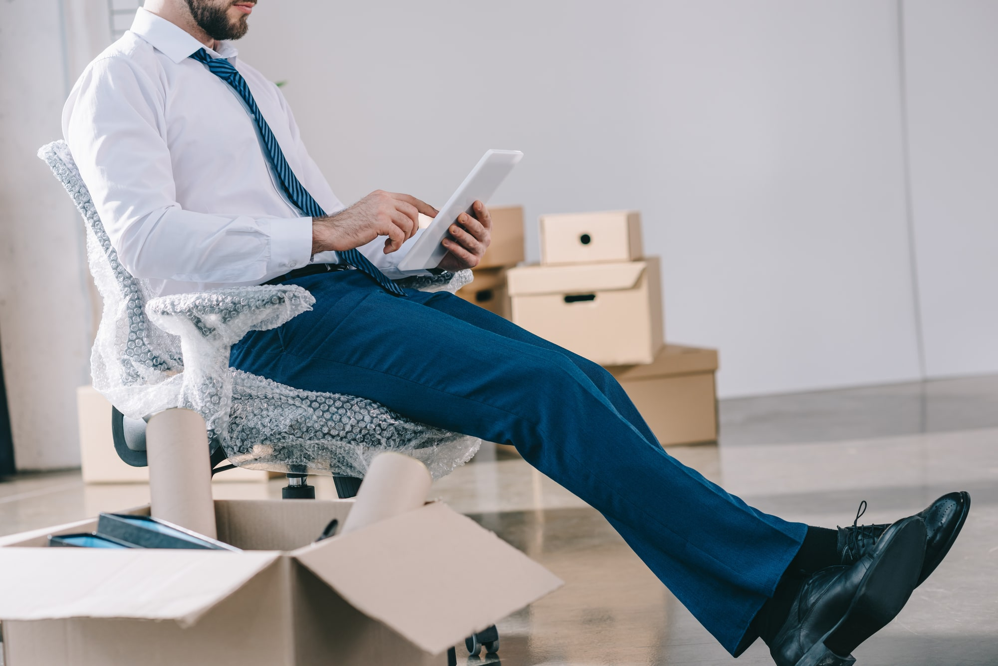 Man on wrapped chair for Office Relocation